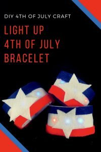 Three red, white, and blue bracelets with 4th of July text above