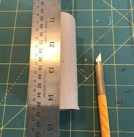 Score the empty toilet paper tube