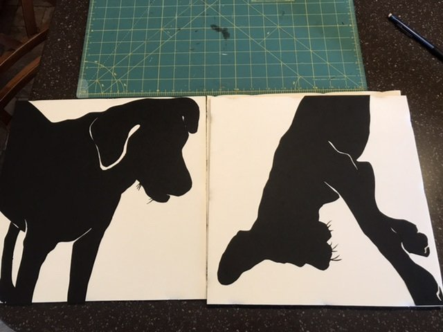 Cut outs of dog silhouettes