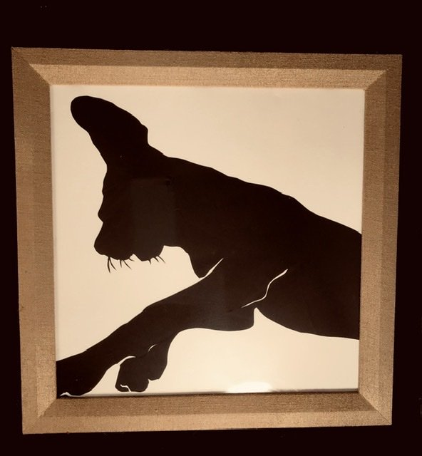 Dog silhouette laying down